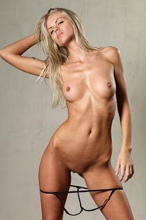 Blonde Simona shows off her tiny, tight panties-14