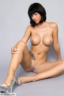 Tattooed angel showing her huge breasts-01
