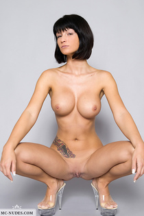 Tattooed angel showing her huge breasts-02