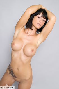 Tattooed angel showing her huge breasts-05