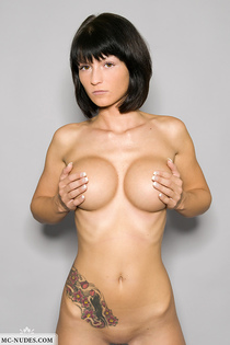 Tattooed angel showing her huge breasts-07