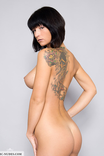 Tattooed angel showing her huge breasts-09