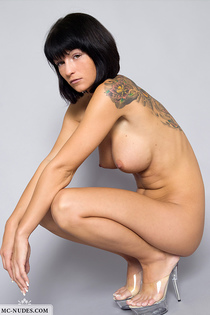 Tattooed angel showing her huge breasts-10