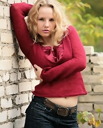 Curly blonde Katya taking off her jeans