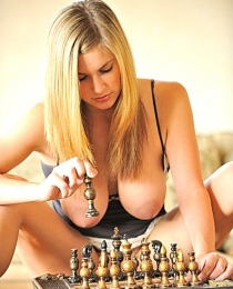 Danielle playing chess naked