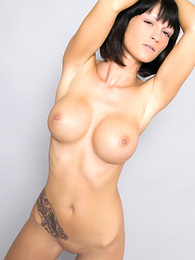 Tattooed angel showing her huge breasts